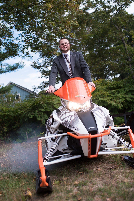 groom with four wheeler