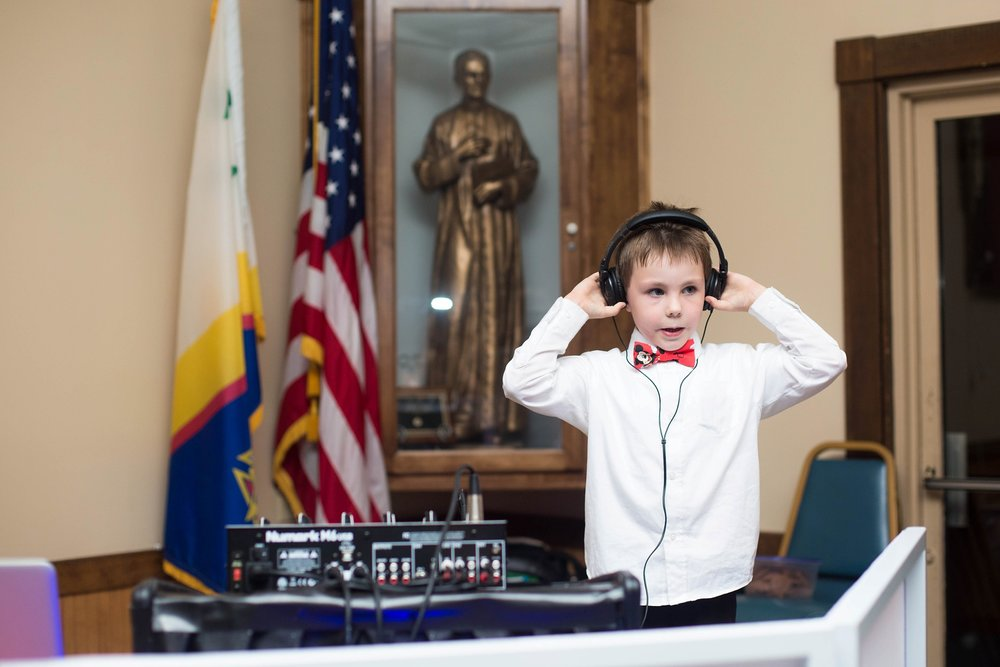 little boy playing dj