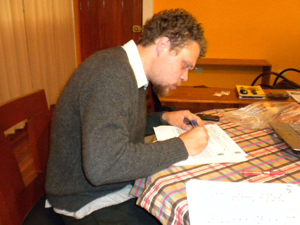 A photo of me grading papers for my students from UNSAAC in  Cusco .