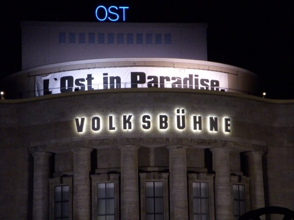 "A photo of a sign that say's ""L' Ost in Paradise"" taken in Berlin Germany"