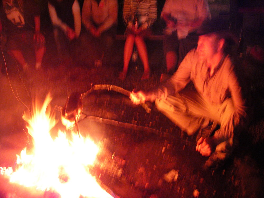 Trevor cooking a chicken over the fire while we are at The Tent Hostel in Münichen.