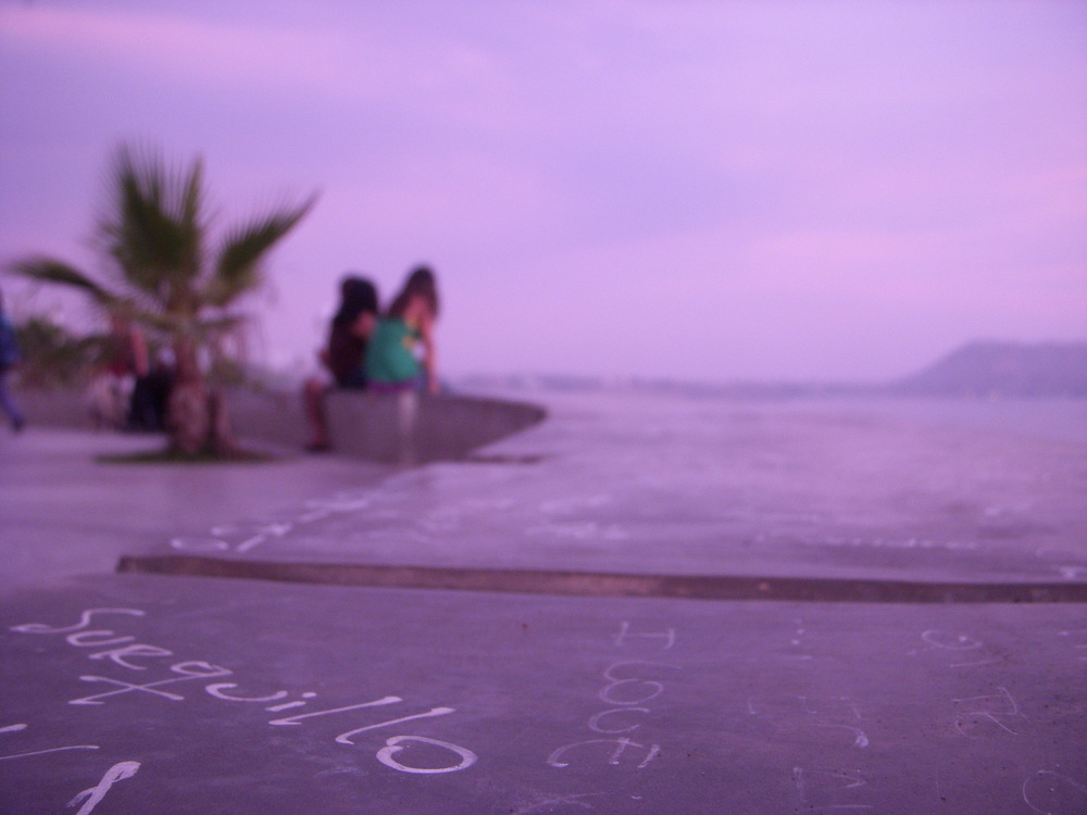 An artistic photo of The sidewalk in Parque Amor in Peru at Sunset.