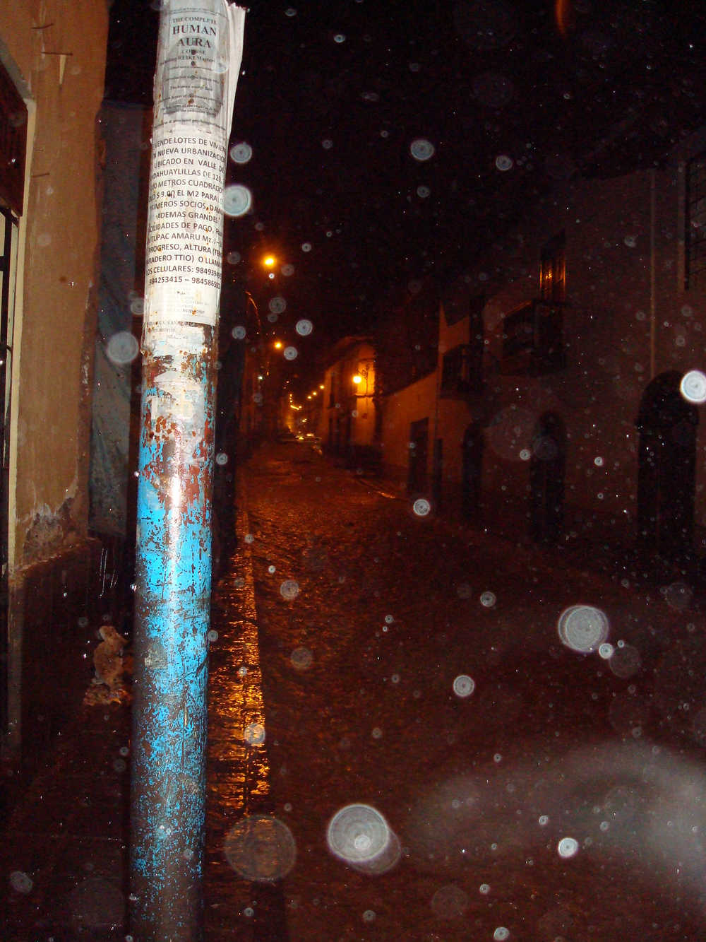 A photo taken by Ami while were both still living down in Cusco Peru during my travel experience of my Jaunt Down South 2010. It showcases how during the rainy season in Cusco Peru, the rain really pours down and the streets turn to rivers. During the peak of the rainy season (i.e. December to February) it can have an average of 133.9 inches receiving 401.7 inches of precipitation of the expected annual 707.8 inches per year in just those three months. Read the Wikipedia Article for more information regarding Cusco's climate.