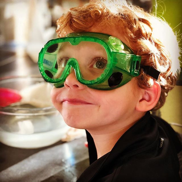 Doing science experiments at OMSI earlier today. He says that he wants to be a scientist when he grows up. Looks like one now.