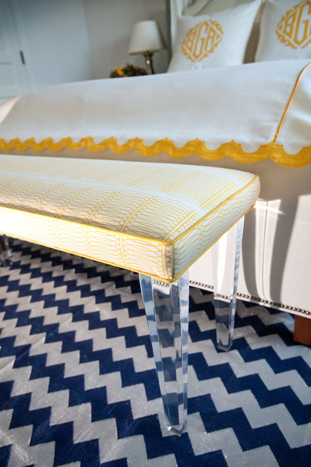 Hello, Sunshine! A scalloped edge detail and a custom bench offer guests a sunny greeting.