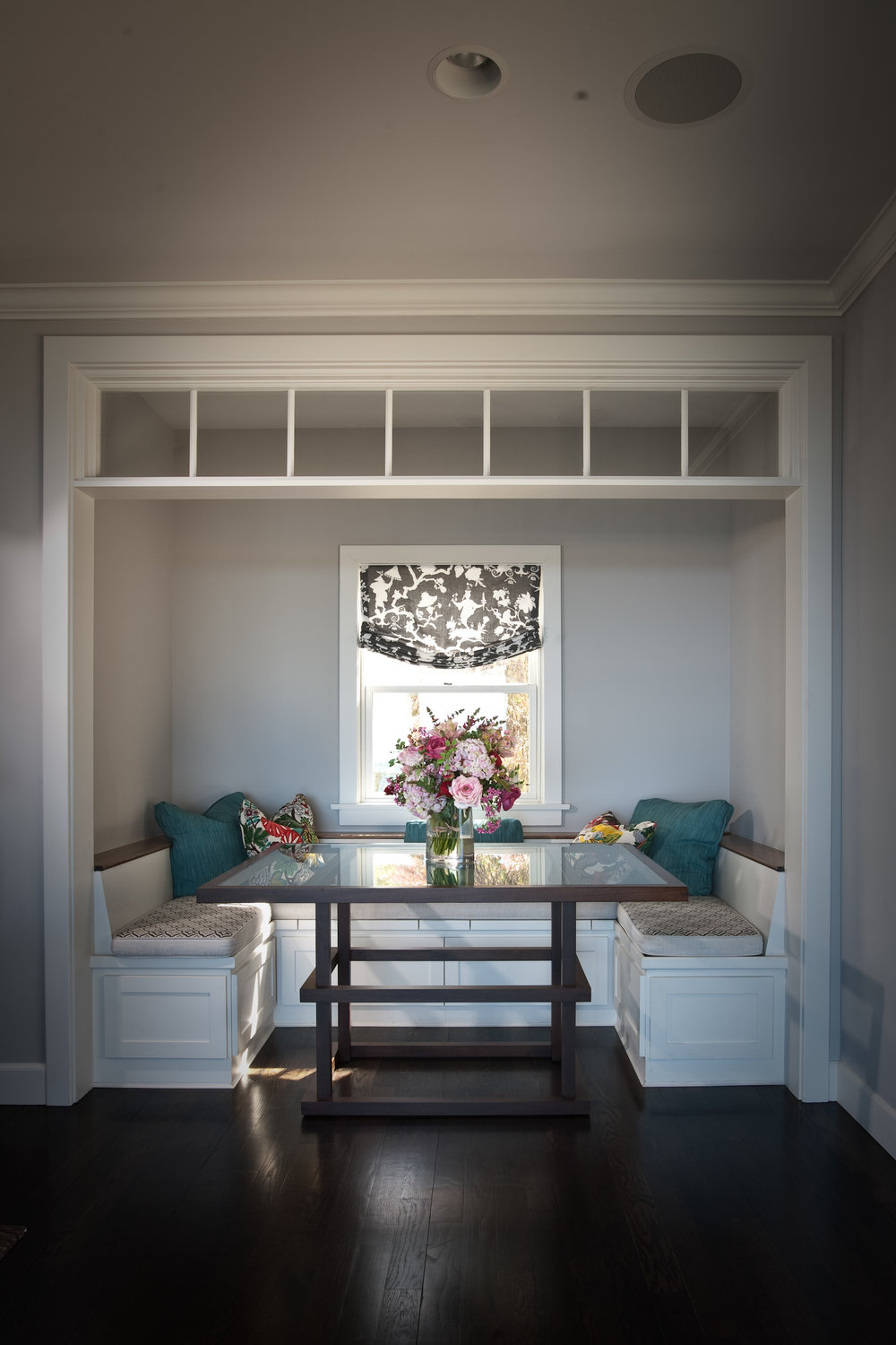 A cozy spot to gather for breakfast or a game of backgammon, this custom dining alcove features custom banquette seating and a bespoke table.