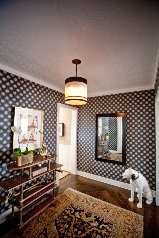 Graphic wallpaper, a vintage dessert cart, Nipper the Dog and a custom shade that was hand-carried from Montmartre to La Jolla. You might call it eclectic.