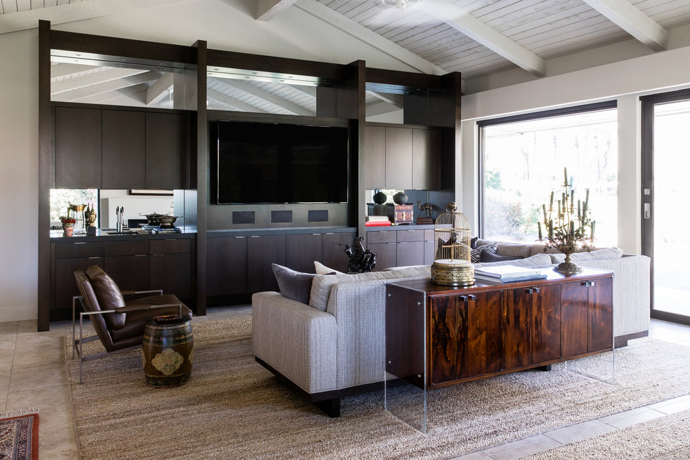 An original mid-century modern buffet anchors the main conversation area.