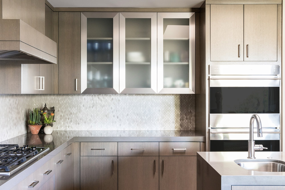 The newly remodeled kitchen is simple, clean, neutral and modern