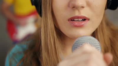 stock-footage-close-up-of-female-singing-and-recording-song-in-studio (1).jpg