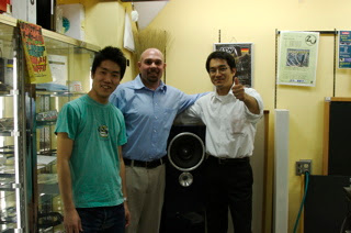 Sato, Adam, and Hiroshi posing with the Maserati Blue Nettuno Druid on display at Audio Union.