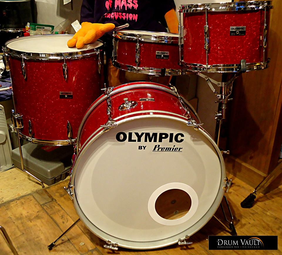 An excellently restored four piece red sparkle Olympic kit.