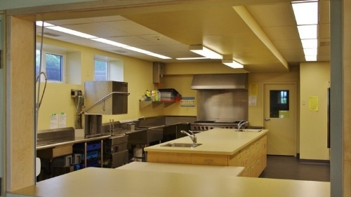 lower kitchen - A well-equipped kitchen with gas stove, dishwasher and plenty of space for preparing meals for large events. This facility is CHR-approved.