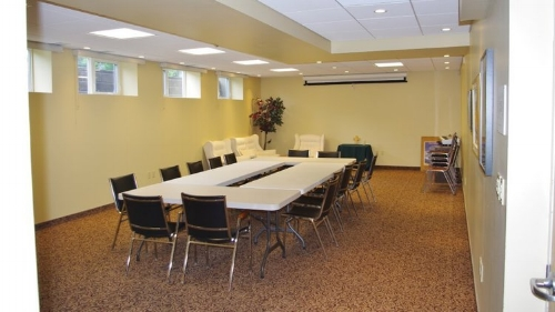 multipurpose room - This is the newest addition available for meetings. This 800 square foot room has a lot of natural light and is very flexible depending on your needs. There is access to internet and a pull-down projection screen.