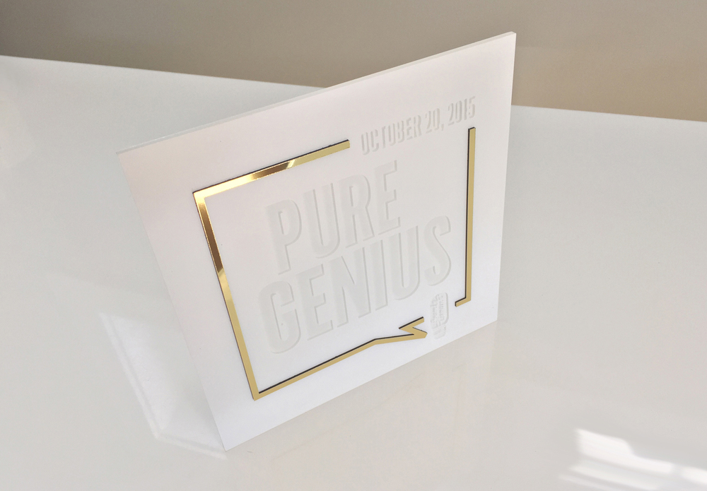 Acrylic invitation with gold Chroma frame. Chrome