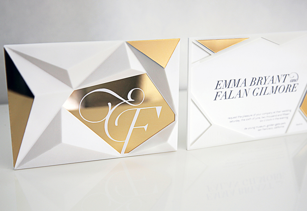 3D-printed invitation featuring geometric facets and gold chrome finishes. A slot in the top of the piece allows an invitation card to slip inside and be visible from the reverse side.