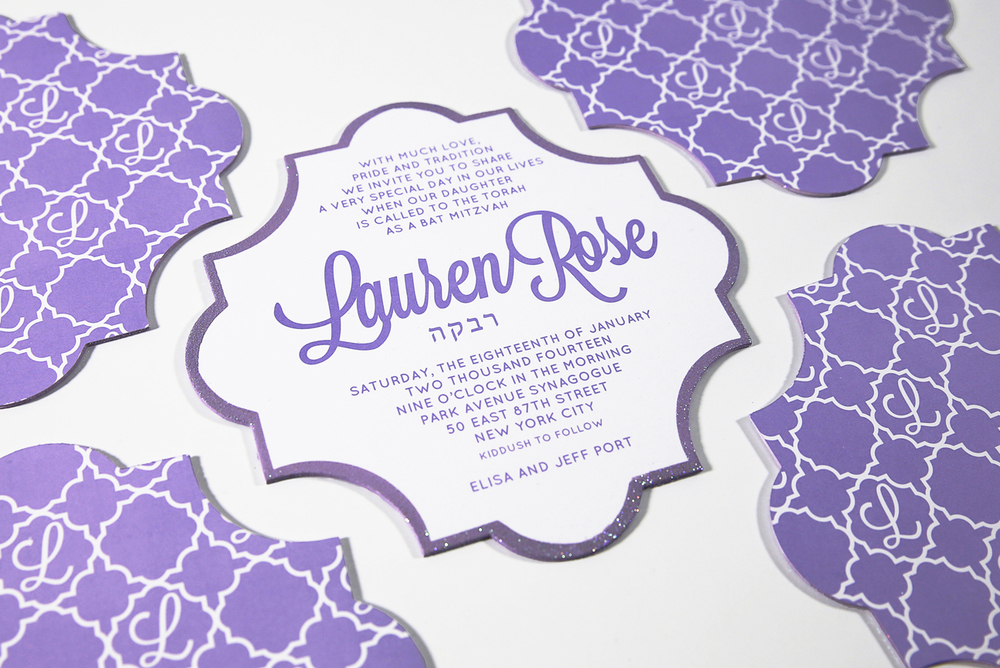 A Bat Mitzvah invitation with feminine style. H  and painted glitter borders and a custom-designed monogram and pattern.