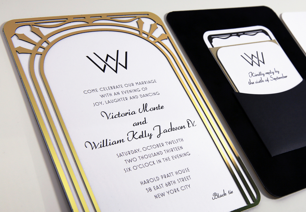 An Art Deco wedding invitation with a custom laser cut gold chrome frame. Mounted to black velvet with a pocket for keeping inserts neat and tidy.