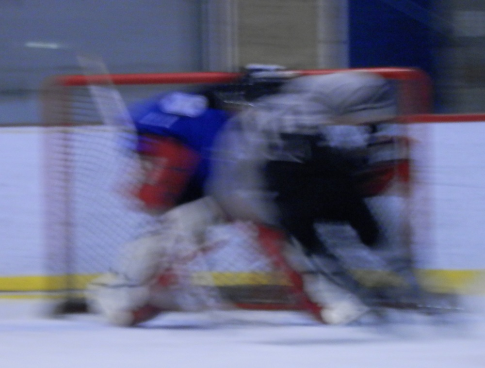 """Ludovic Helias of the bily kun czechers """"blending into""""netminder claude laroche from the pub st-paul avengers during saturday's shoot-out ending (photo jfd)"""