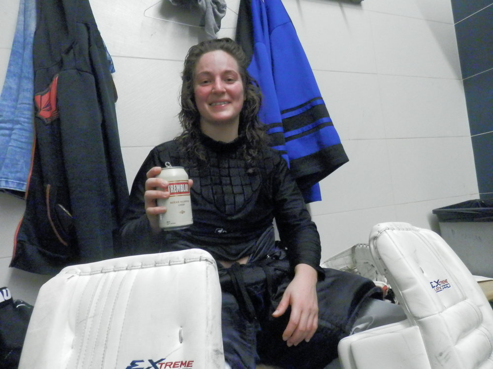 Amélie Champagne, first female goaltender in the LFA's history, savouring a well deserved Tremblay beer!