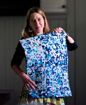 "Maria Shell with her quilt ""Ablation"""