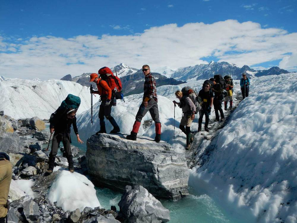 Crossing a glacial stream  Photo by Jesse Wright