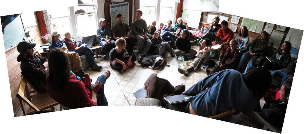 Students and faculty gather in a classroom at the Wrangell Mountain Center for a discussion.