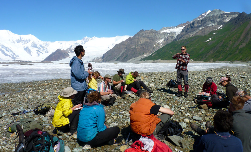 A faculty member gives a lecture on glacier dynamics