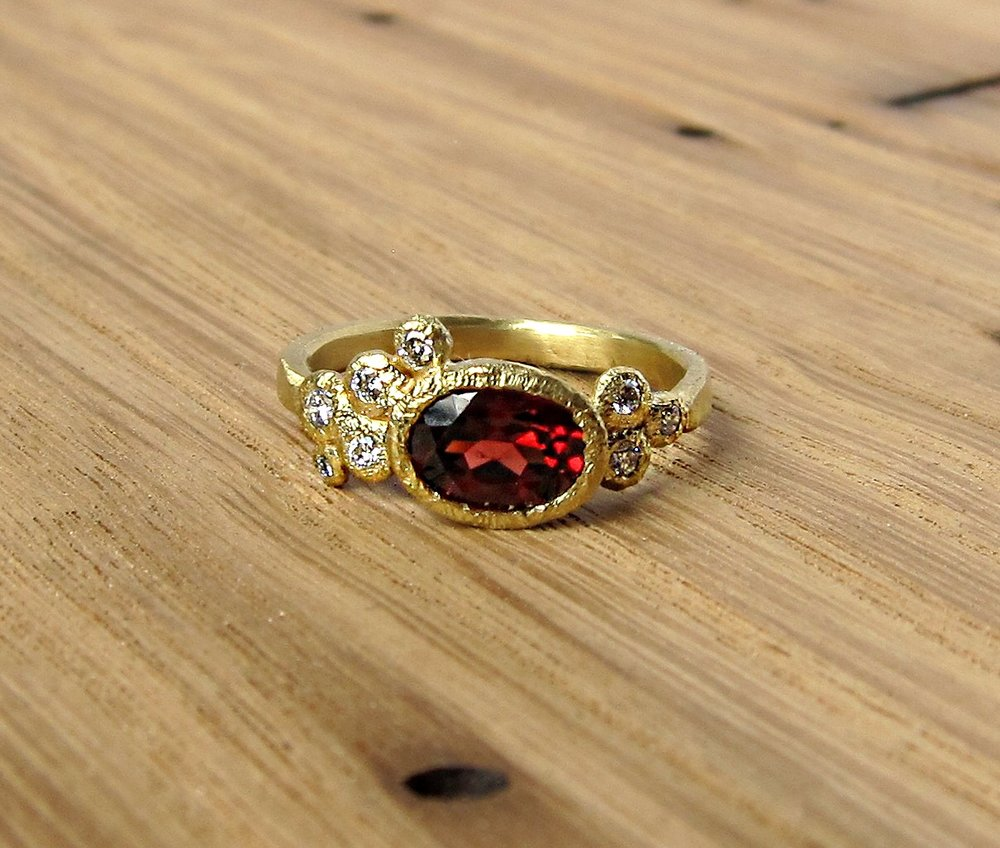 18k Gold, Mozambique Garnet & Round Brilliant Diamond Accents. Sizable from 5-9 and half sizes too.