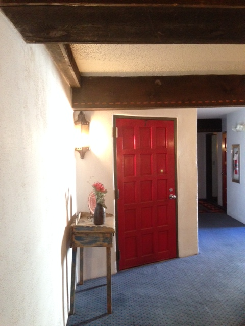 Halls of red doors and wooden beams