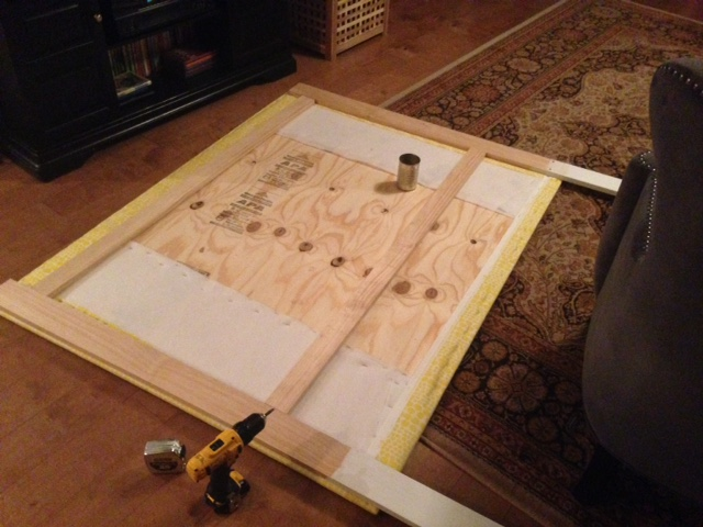 Step Seven: Paint wood frame (that will show from front and side of bed) then line up on back of frame to add sturdiness to headboard. Use drill and screws to attach to plywood.