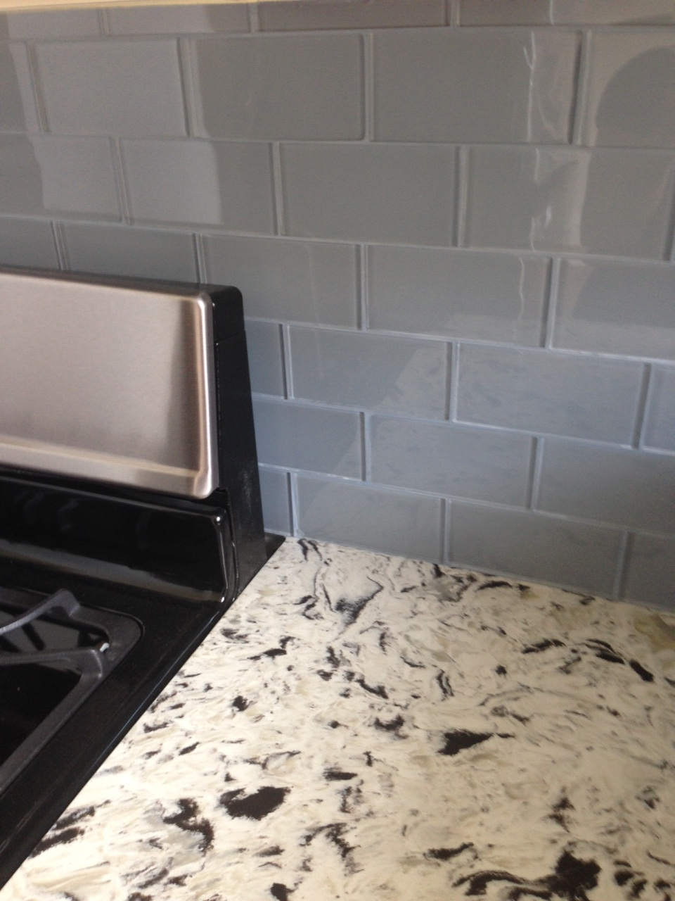 The kitchen granite counters and subway backsplash are gorgeous. How can we even afford this place?!?