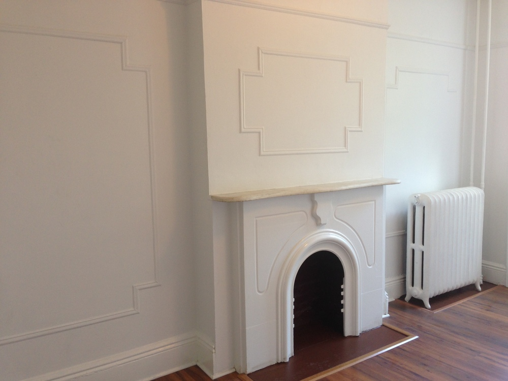 Non-working fireplace in master bedroom.