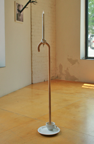 "The Middle Name, 2011; found objects, wax, plaster, and adhesive 48"" X 10"" X 10"""