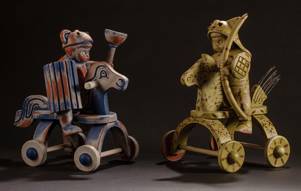 "2 Mounted Warriors (Blue Bear & Green Kitty), glazed & stained terra cotta, acrylic eyes, broom straws, 13""h X 9""w X 12""d (each), 2011"