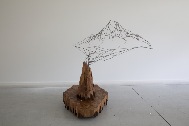 Greg Pond, Stump Errupts a Mountain  2011, wood steel