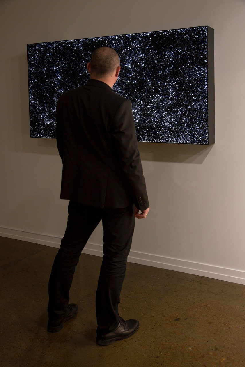 "My God, It's Full of Stars, vinyl pellets on lightbox, 36""x66"", 2014"