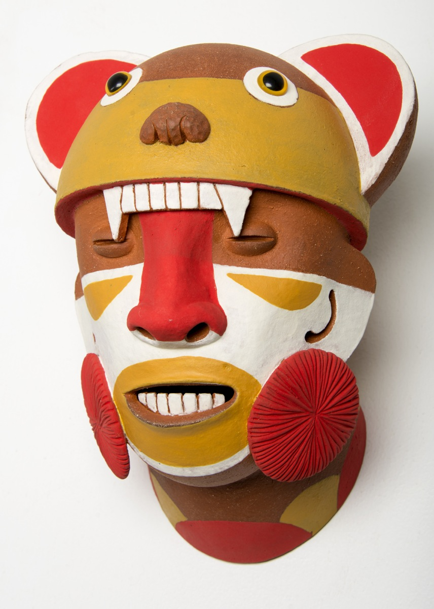 "Bear Shaman Head: Warm, earthenware, underglazes, mixed media, 11"" in height, 2013"