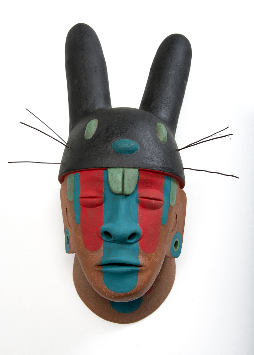 "Bunny Shaman Head: Waking, earthenware, underglazes, mixed media, 12"" in height, 2013"