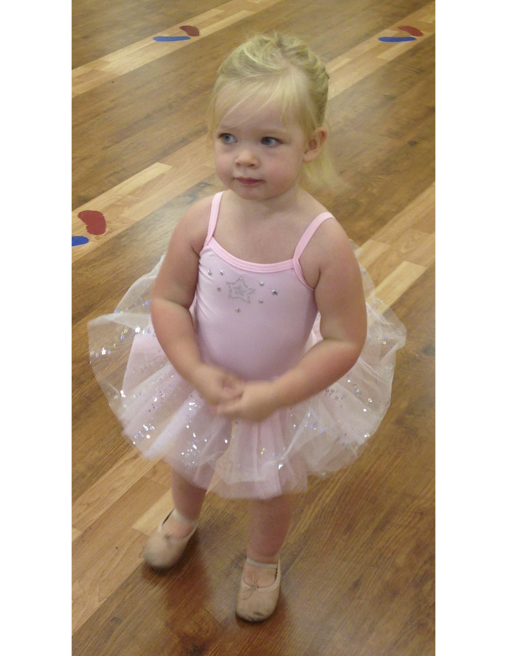 Check out this tiny ballerina in her sparkly tutu and ballet shoes!