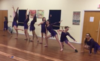 Advanced lyrical practicing with their new costumes.