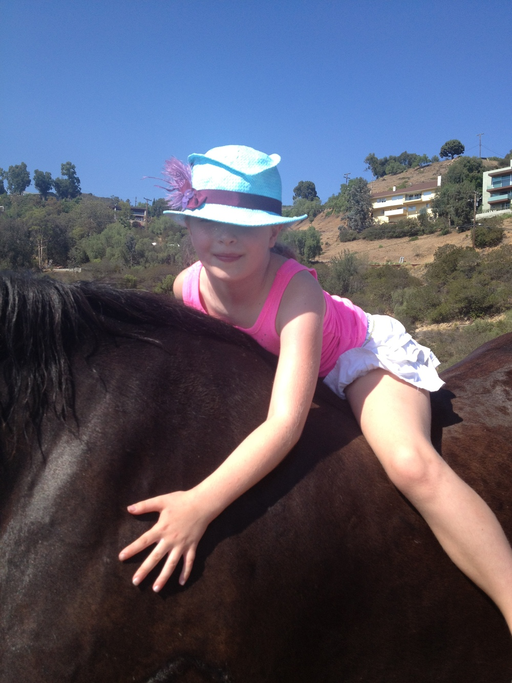Before each ride the children were encouraged to greet the horse by hugging him and whispering a hello.