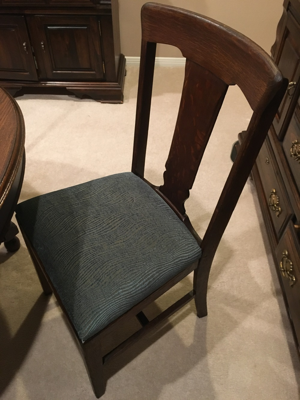 Reupholstered and refinished antique chair