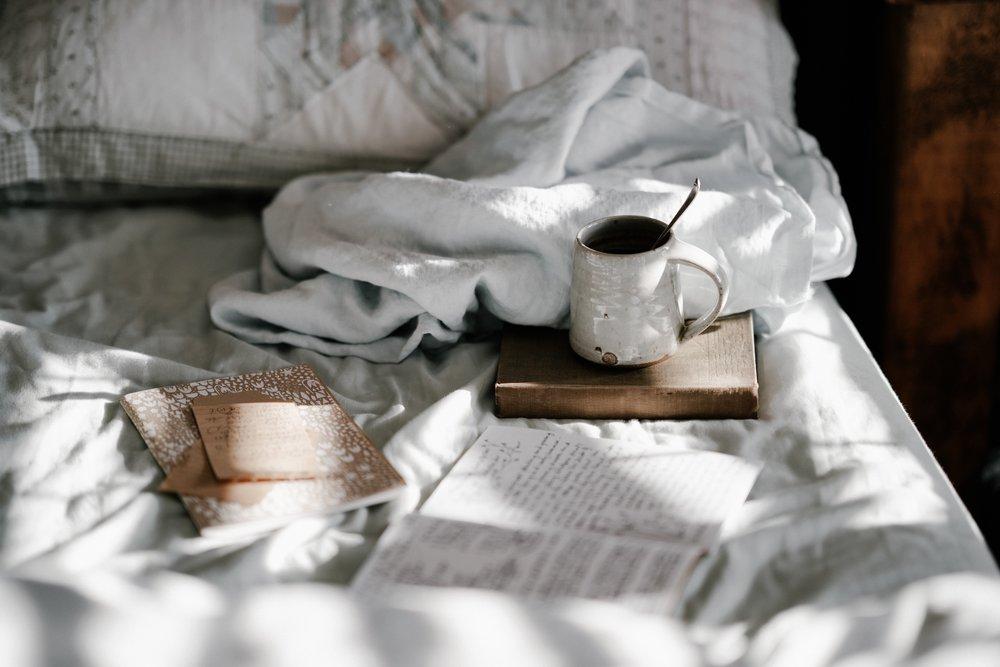 Relax-book-and-mug-on-bed-annie-spratt-583427-unsplash.jpg