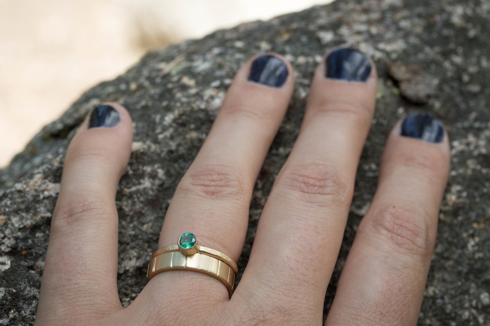 The  Granite Emerald  and  4mm Breakwater  rings