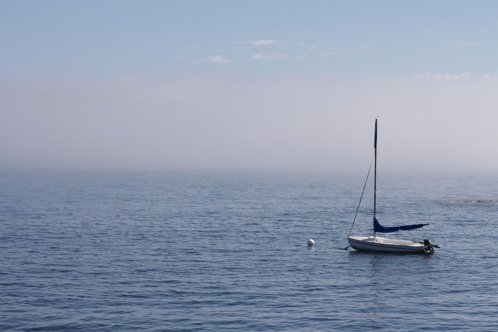 sailboat and the morning fog rolling out nova scotia