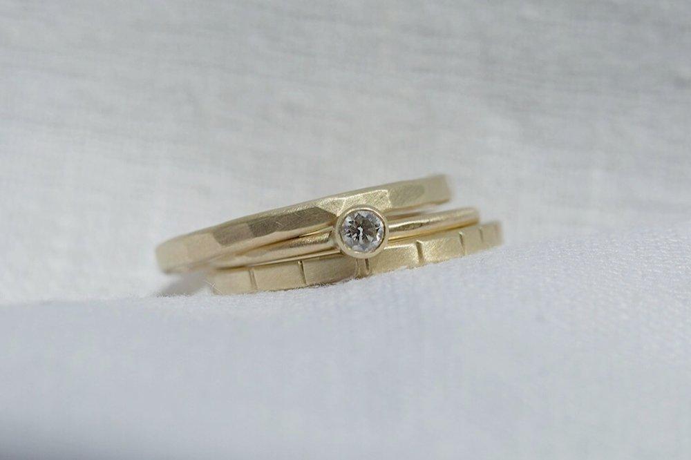 the  Mitla ,  Diamond Oaxaca , and  Breakwater  rings in 14k yellow gold.