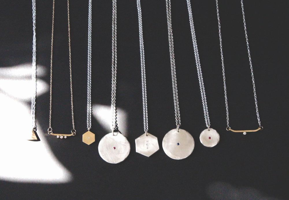 Ida ,  Alpine Trio ,  Ruby Odessa ,  Diamond Hexagon,   Sapphire Odessa ,  Small Ruby Odessa , and  Alpine Diamond  necklaces