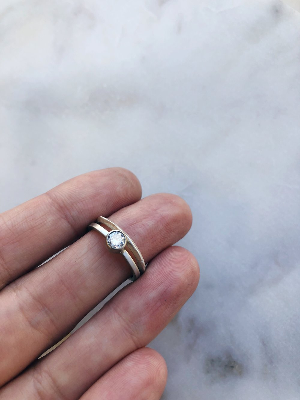 More mixed metal, a custom 14k white gold Diamond Beacon ring with a sterling silver  Ridge  band