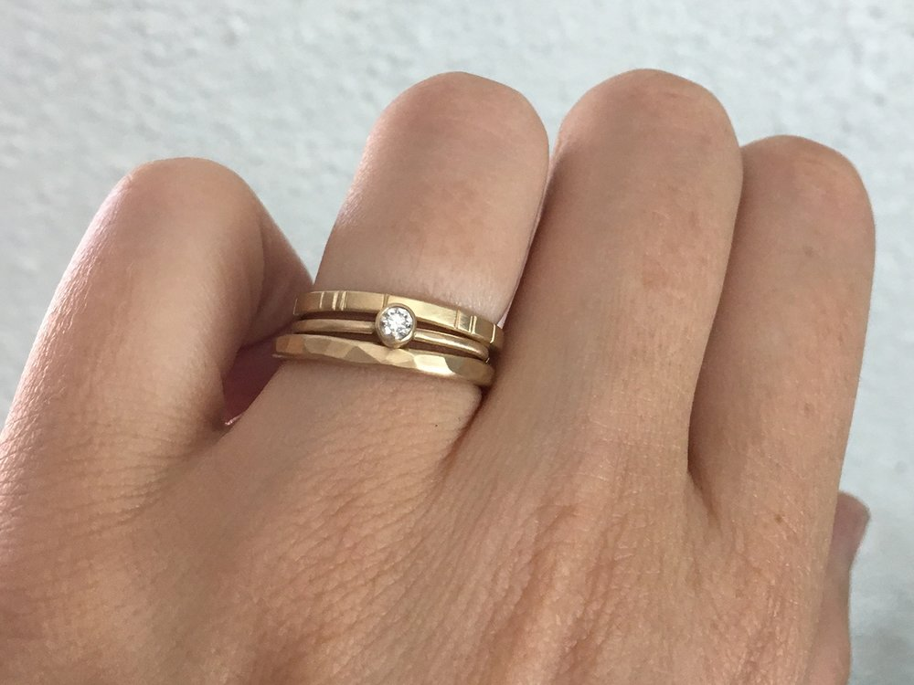The  2mm Mitla ,  Diamond Oaxaca  and  2mm Breakwater  rings all in 14k yellow gold.